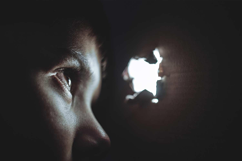 boy-looking-through-a-hole-in-wall.jpg