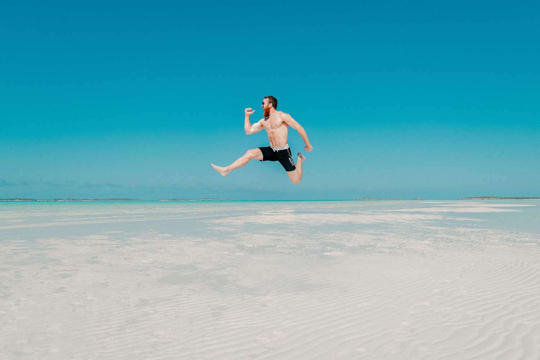 man-jumping-in-blue-sky-1.jpg