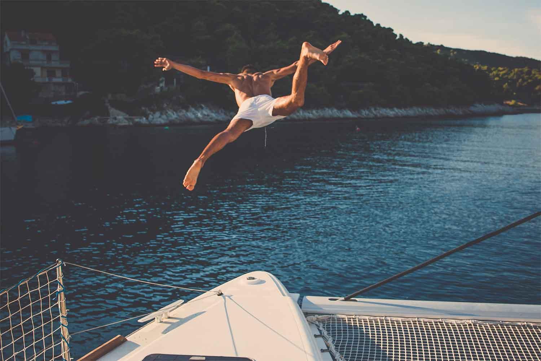 man-jumping-off-boat-into-ocean.jpg