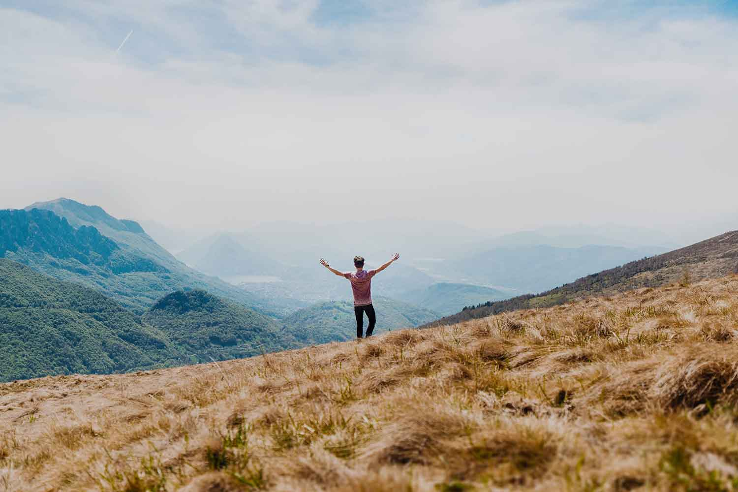 man-with-arms-up-over-beautiful-scenery.jpg