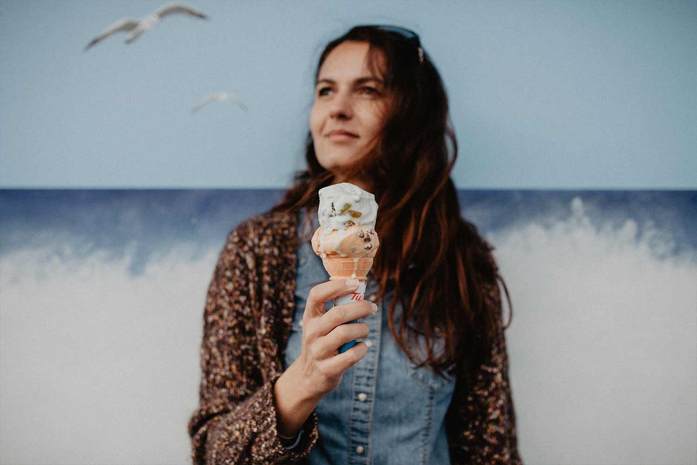 woman-eating-ice-cream-at-seaside.jpg