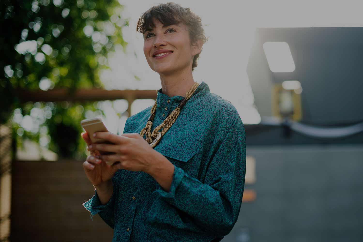 woman-smiling-with-phone-in-hand.jpg