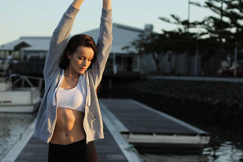 woman-stretching-on-pier.jpg