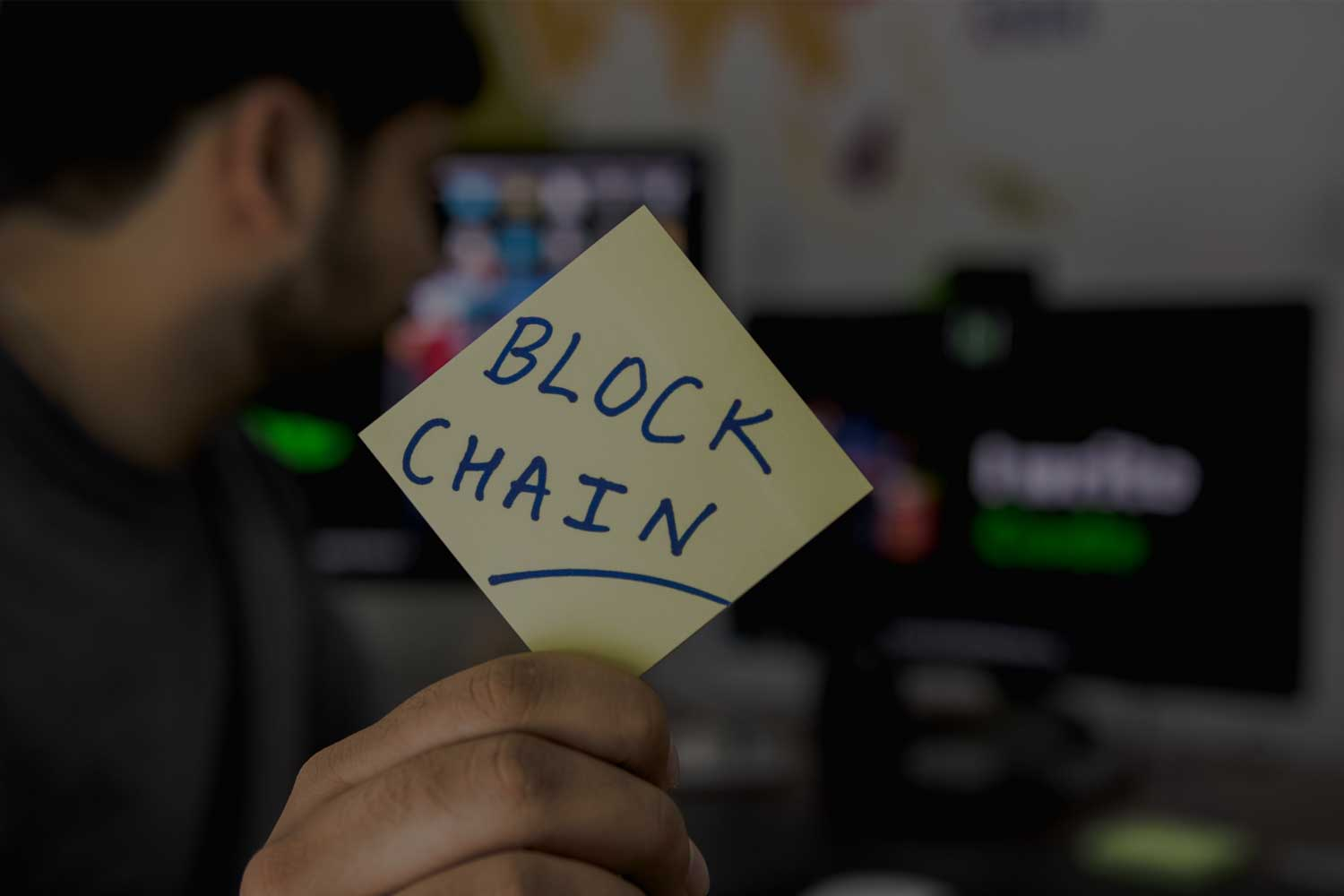 Post-it note with blockchain written on it
