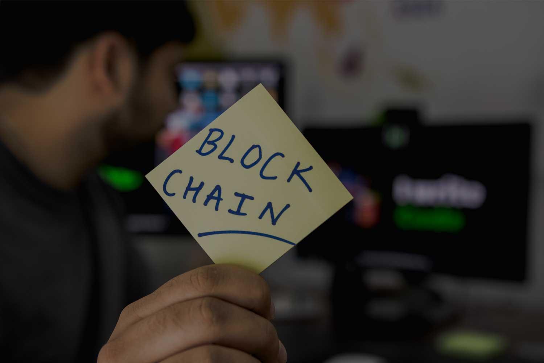Post-it note with blockchain written on it
