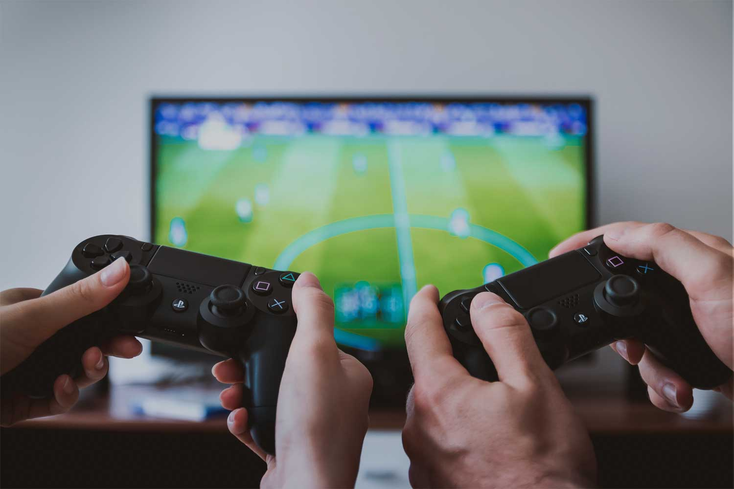 Two gaming controls infant of FIFA
