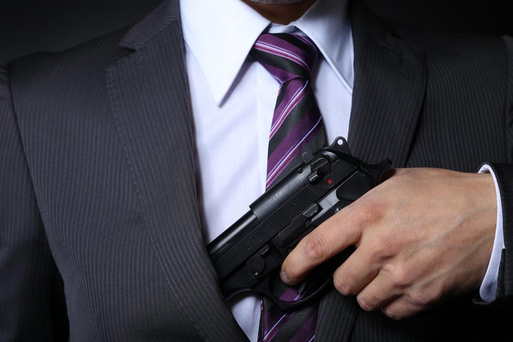 man-in-suit-with-gun.jpg