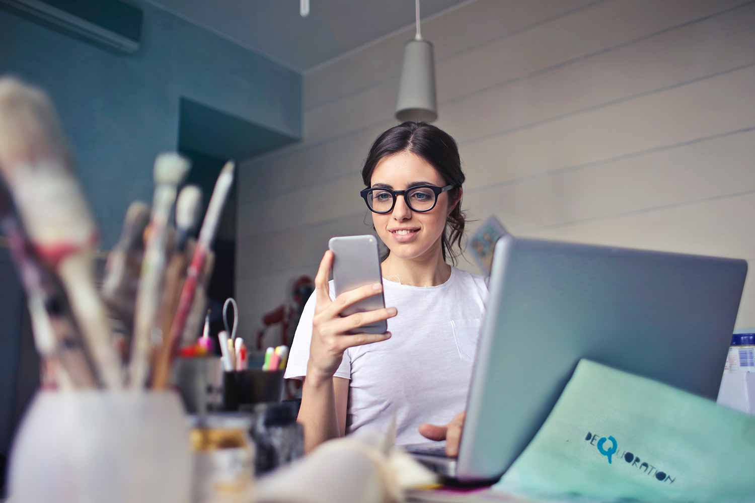 woman-checking-emails-on-phone