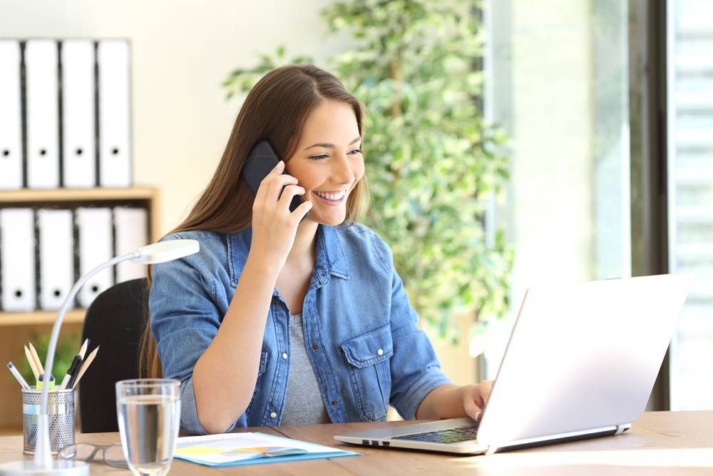 woman-happy-on-phone-working.jpg