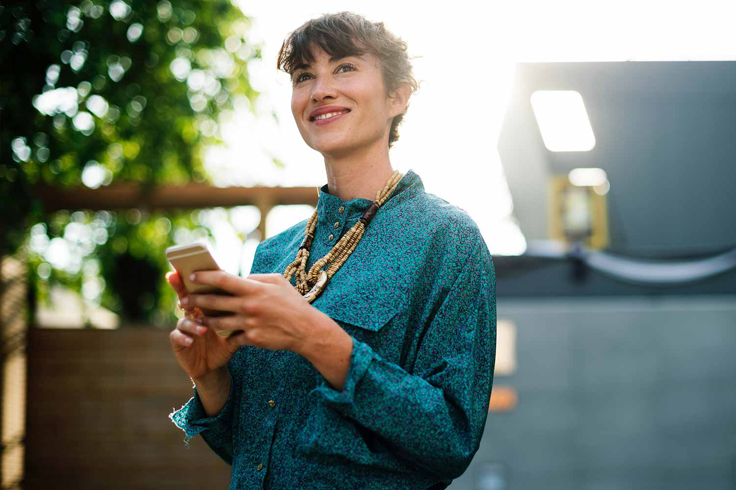 woman-smiling-on-phone
